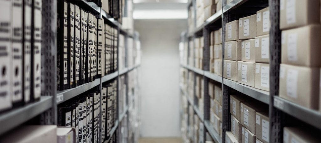 boxes and files stored on shelves in storage facility