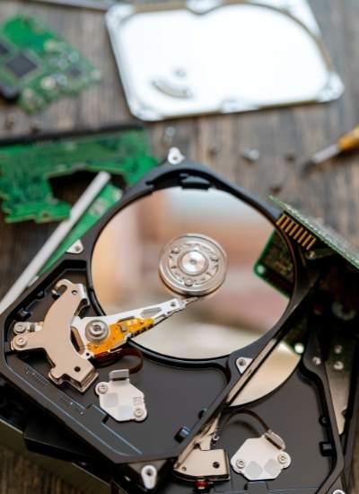 Hard drive taken apart on a desk